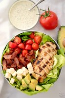 grilled chicken on a BLT salad with a side of creamy pesto ranch dressing