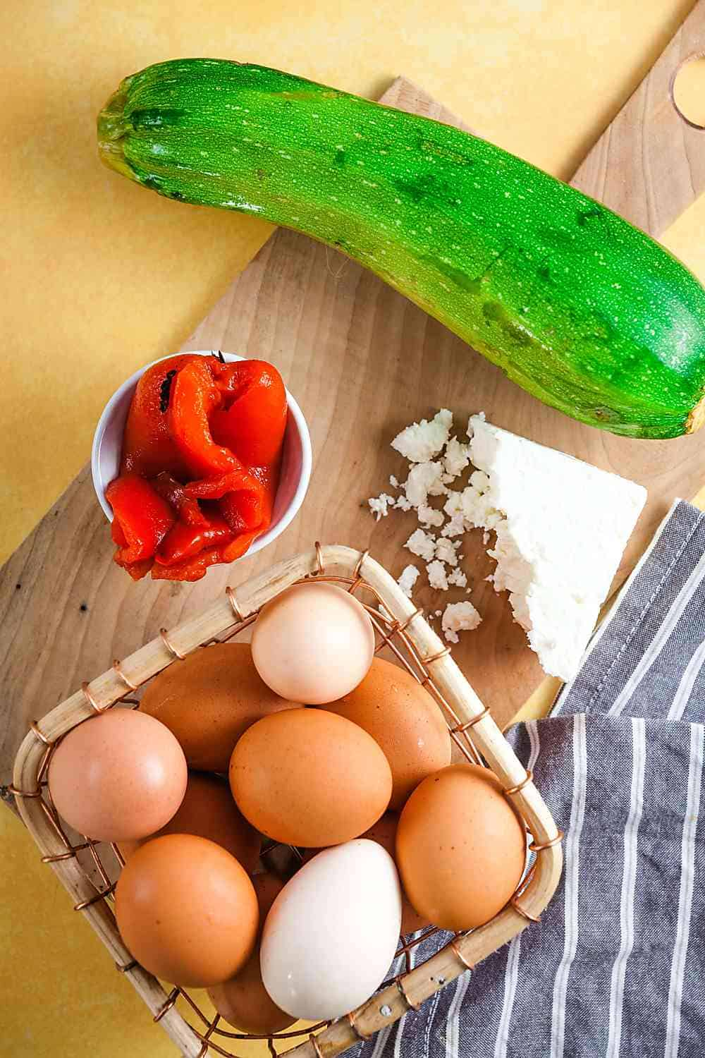 Zucchini, roasted red peppers, feta, and eggs