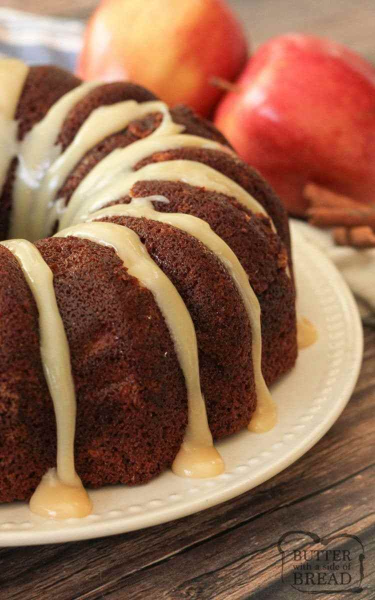 apple spice cake with caramel frosting on a white plate