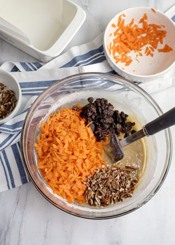 Adding in carrots, raising, and pecans to Carrot Cake Loaf