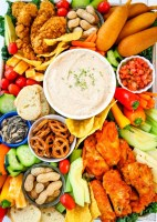 Smoky Homemade Ranch Dip served with all your game day favorites: hot wings, chicken strips & more! Wow the crowd with this savory game day snack tray that's delicious & easy to put together.