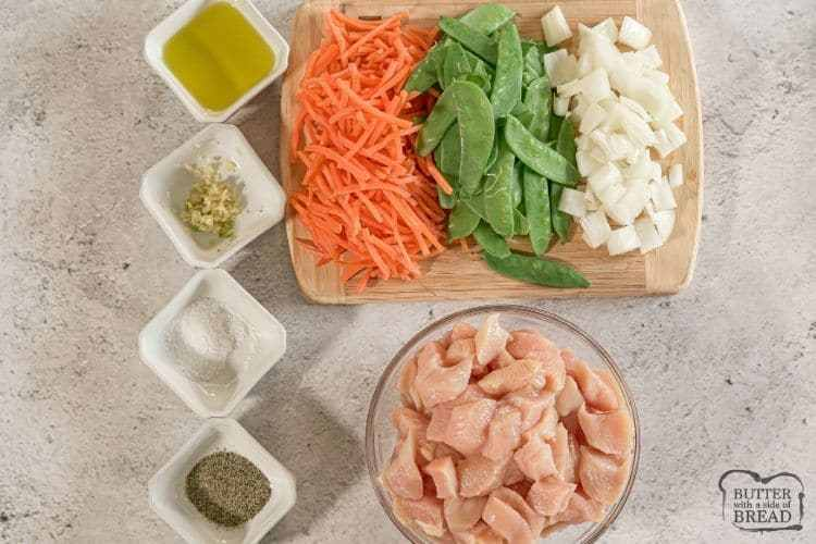 bowl of olive oil, garlic, salt, pepper, chicken, snow peas, carrots and onion