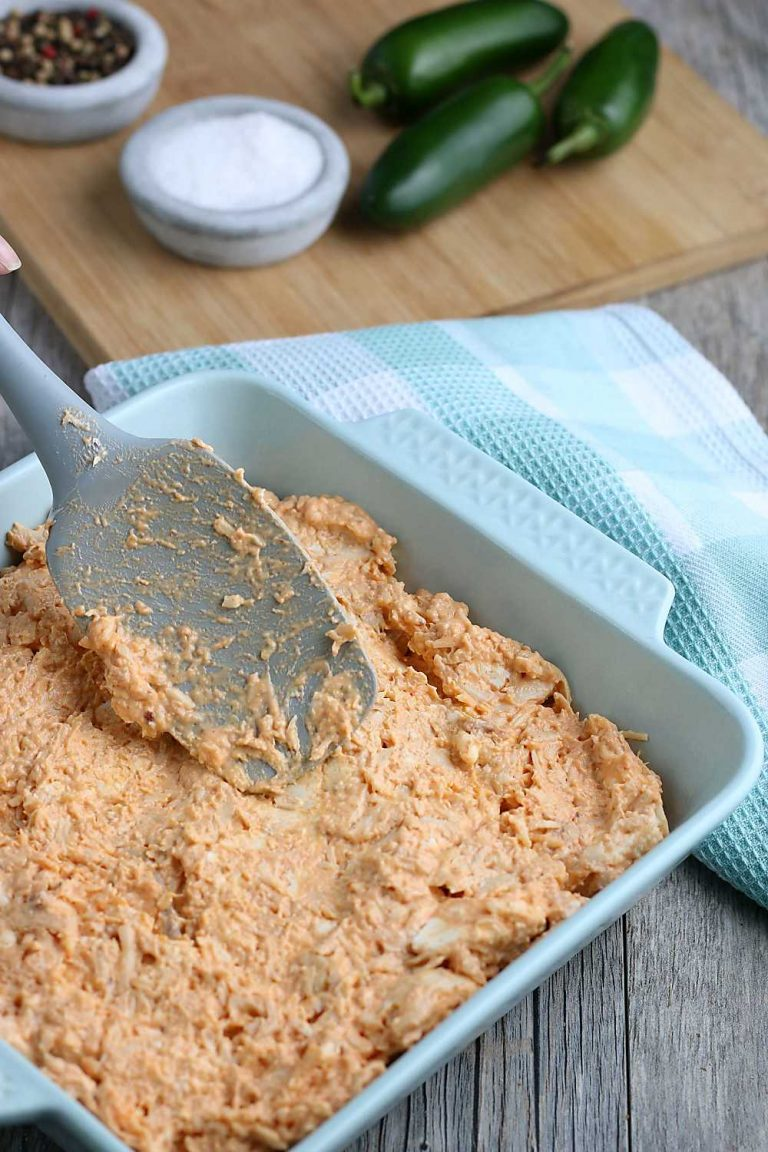 One the Buffalo chicken dip ingredients are mixed together, spread them into a casserole dish or add them to you slow cooker