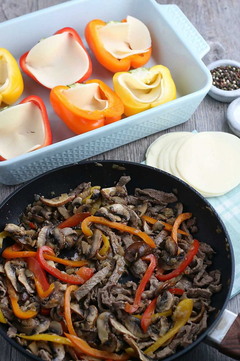 The first step is to cook the filling for our stuffed peppers, the peppers are waiting in a pan to be stuffed.