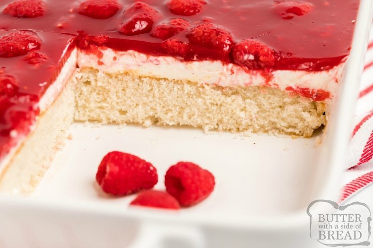 White cake mix with whipped cream and glazed raspberries on top