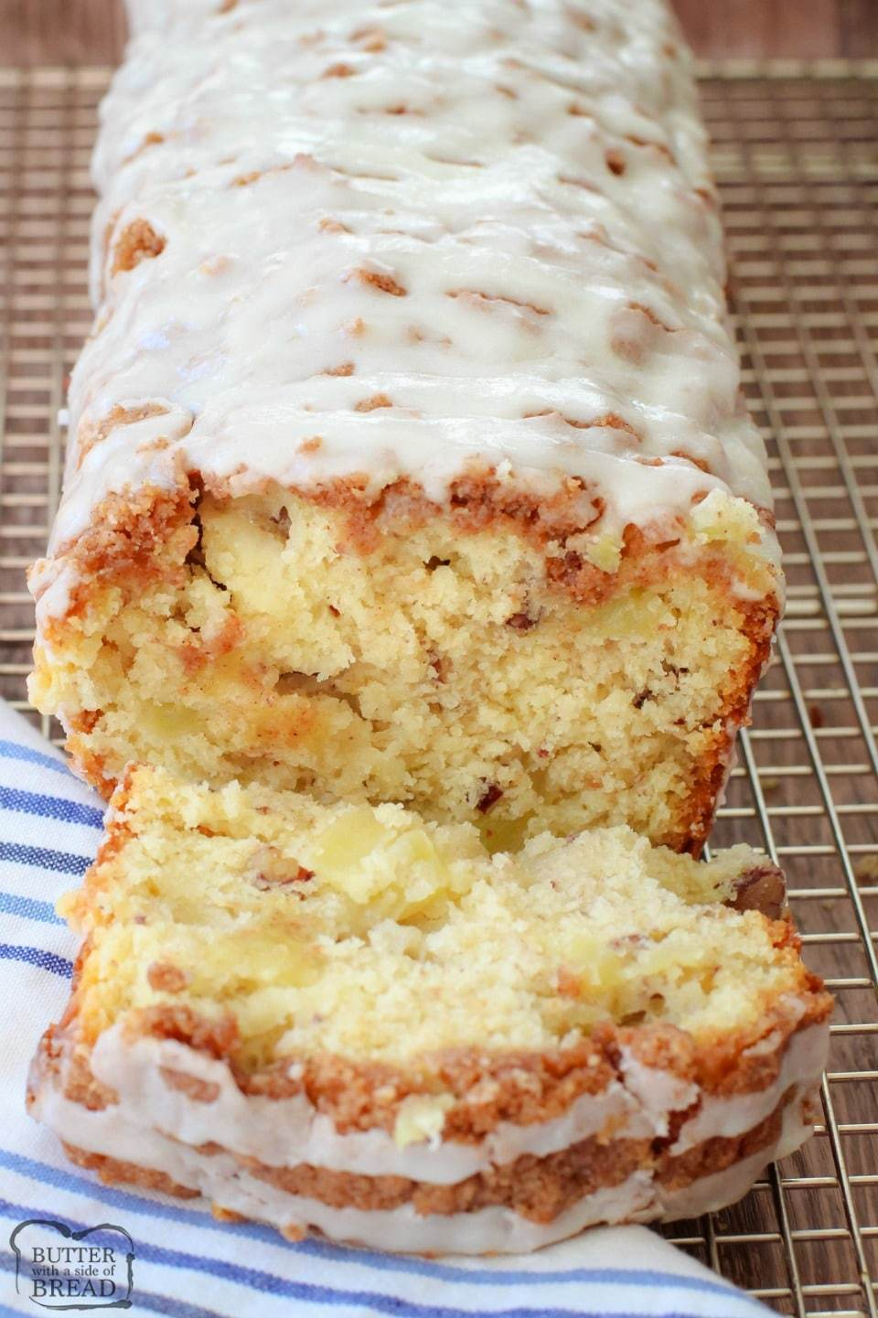 Dutch Apple Bread made from scratch with butter, sugar & fresh apples. Amazing flavor in this apple quick bread recipe topped with a cinnamon streusel & drizzled with warm vanilla glaze.