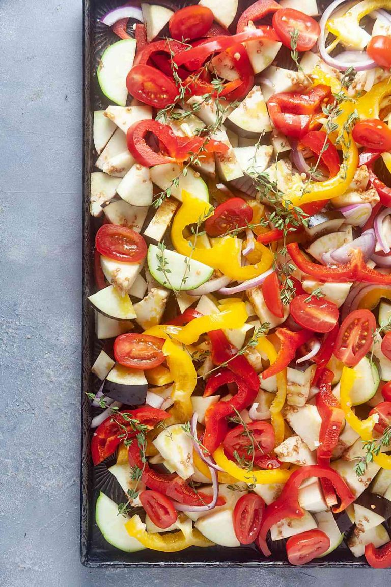 Sliced fresh vegetables on a sheet pan