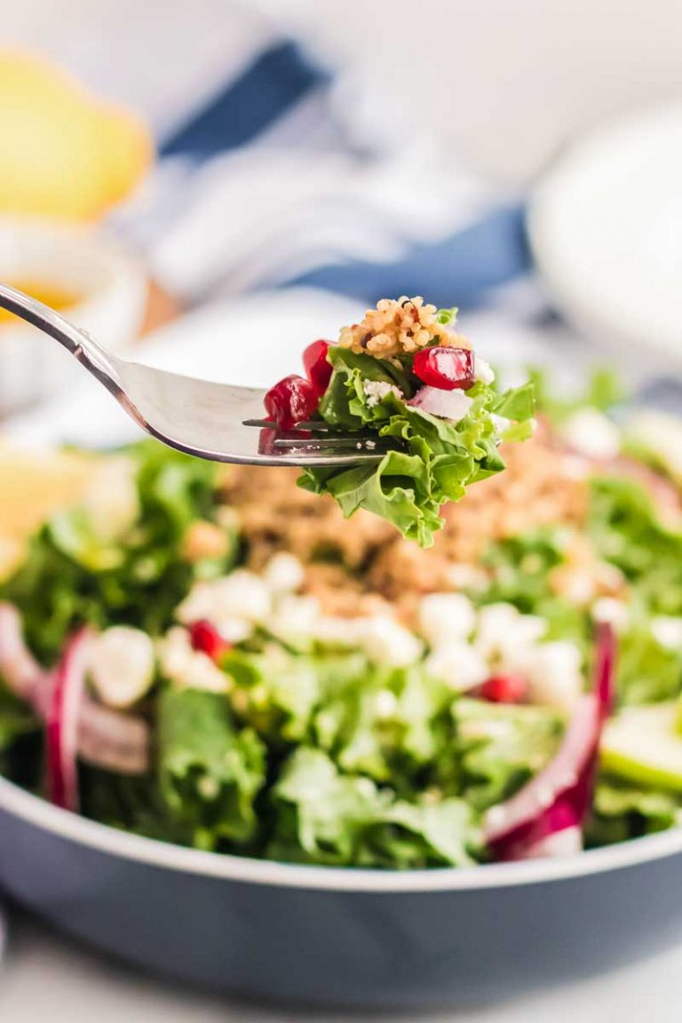Fork full of massaged kale salad