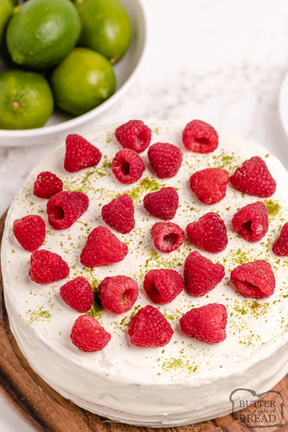 Key Lime Cake made with a cake mix and tons of lime flavor! Add fresh berries and a lime flavored whipped cream for a light, refreshing dessert that looks much fancier than it is!
