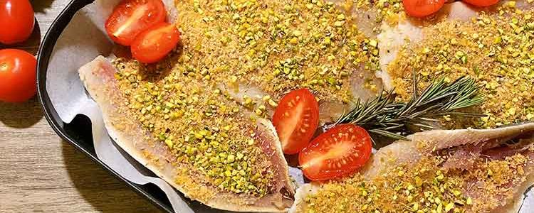 Baked herring fillets with chopped pistachios