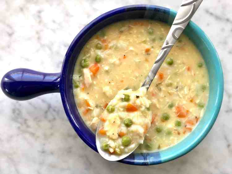 chicken and rice soup in blue bowl